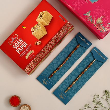 Traditional Pearl Studded Rakhis Set Of 2 With 250 Gms Soan Papdi