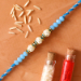 Sea Blue Pearl Rakhi With Almonds And Cashew